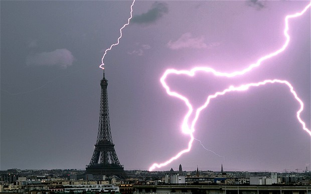 Lightning strikes the top and to the side of the Eiffel Tower in Paris Photo: BERTRAND KULIK/CATERS